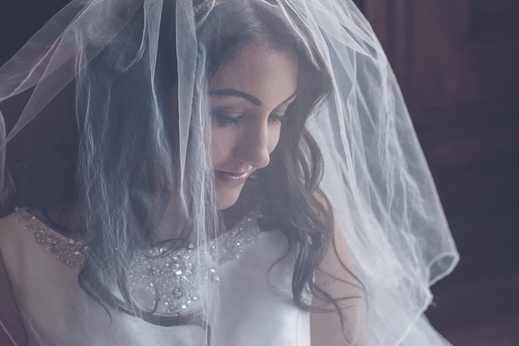 Wedding Photography featuring veiled bride