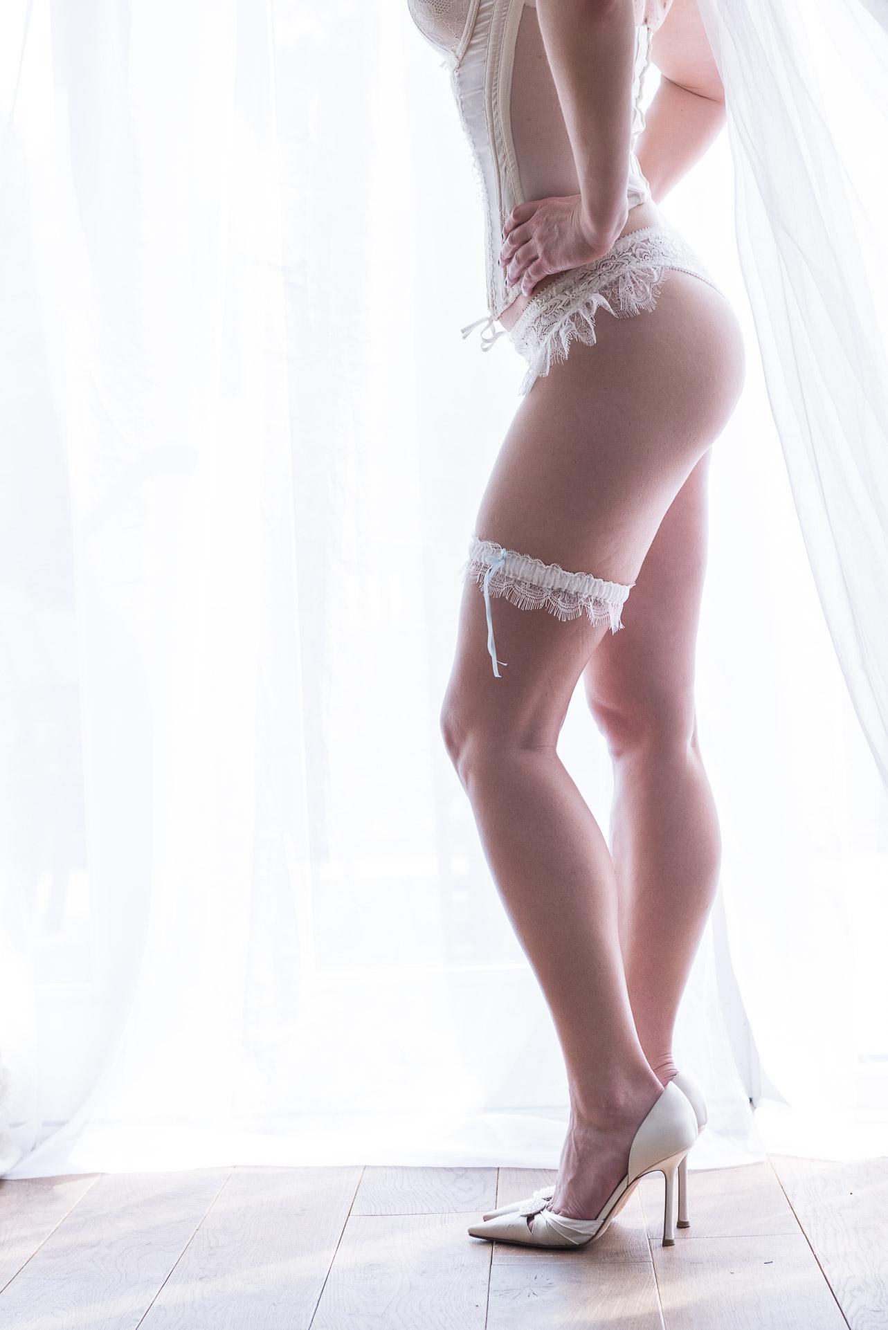 Bridal Boudoir photography featuring bride showcasing designer lingerie and veil