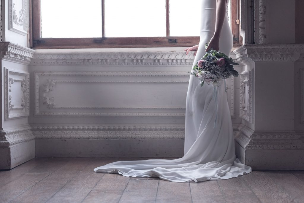 Investment wedding photography detail shot showcasing brides bouquet and featuring panels of National Trust Claydon House