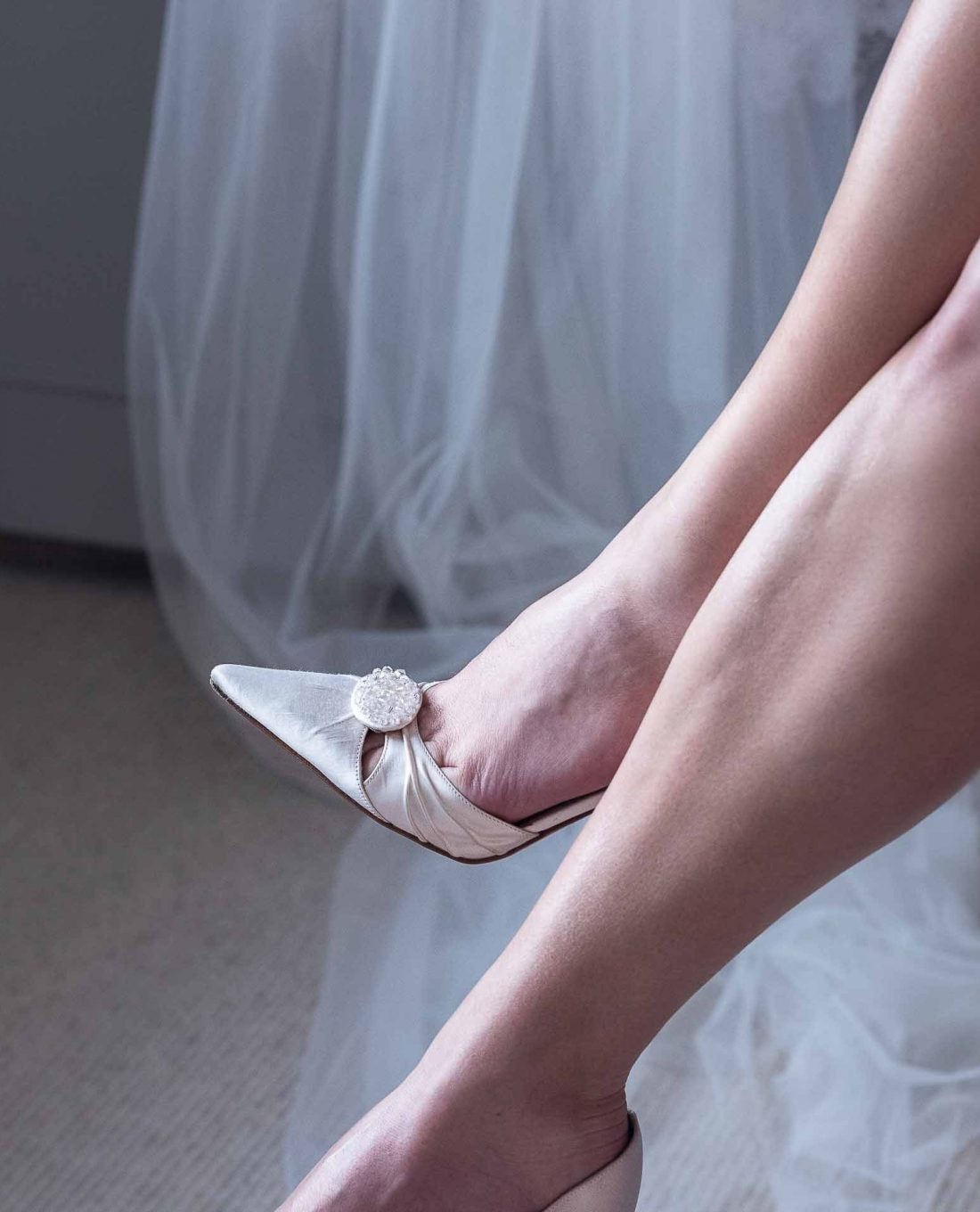 Wedding Photography showcasing ivory Jimmy Choo shoes and veil