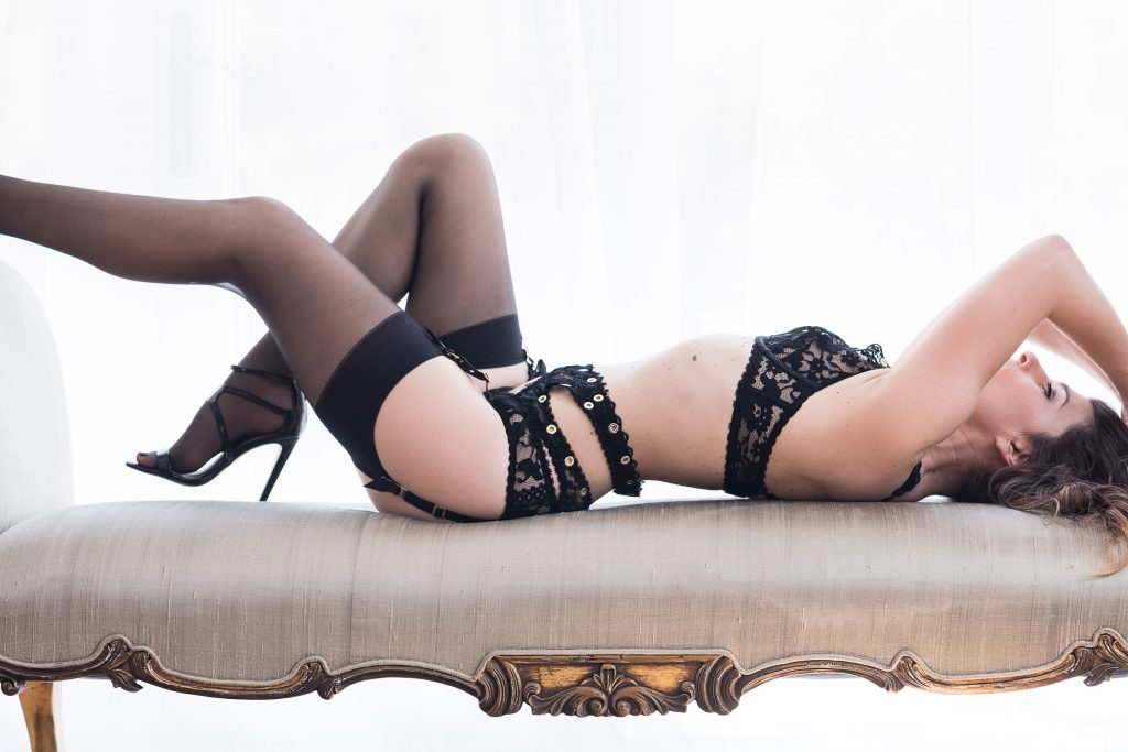 Boudoir Photography showcasing lace designer lingerie, stockings and suspenders